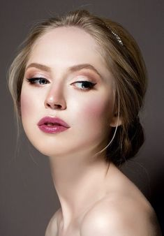 A simple hair adornment accenting a loose bun and wispiness around the face * http://www.queenlila.com/tutorial-valentines-day-makeup-easy-fresh-date-night-look/
