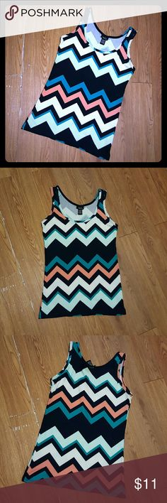 Cute Multicolor Chevron Tank Top This is a classic tank top with a multicolor chevron pattern. Size L but fits more like an M. It stretches.  92% Polyester, 8% Spandex Rue 21 Tops Tank Tops