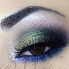 This look uses different shades of green eye shadow and blue eyeliner to give the usual smoky eye an update. This night out eye makeup is made more dramatic with strong black liner and lush lashes.