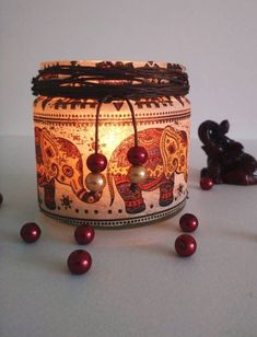 This decoupage candle holder is a must-have home decor. It is decorated with a very stylish indian elephant-pattern napkin, and some beads. Tea Light Holder, Tea Lights, Candle Holders, My Etsy Shop, Table Lamp, Candles, Indian, Unique Jewelry, Handmade Gifts