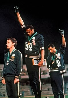 Tommie Smith and John Carlos making History at the 1968 Mexico Olympics