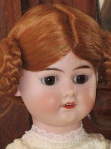 Antique bisque doll (in porcelain) in impeccable condition with a modern composition body. The wig is made of mohair. The original eyes are glass and fixed.It measures about 39 cm.  On the back of the head it has a mark with the No. 4.  Its manufacture of unknown origin.