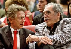 In this Dec.13, 2002 file photo, film director Roman Polanski, left, and Colombian Nobel laureate Gabriel Garcia Marquez speak during the cl...
