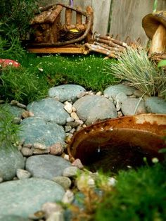 I'm collecting pieces for a fairy garden.  Here's one inspiration that I like.  There are a lot of homemade elements.