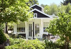 Light and bright with ample windows and glass-paned French doors, this petite garden guesthouse would make a lovely in-law unit or space to house visiting friends. Well-planned landscaping and a design that coordinates with your home can help a backyard structure blend in! - posted by KevinAndDianeCummins https://www.instagram.com/kevinanddianecummins - See more San Diego Real Estate photos from San Diego Realtors at https://NewHomes