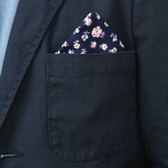 Floral Handkerchief folded oh so nicely and tucked into a midnight suit coat.