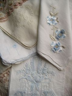 Old Linens.  I still have the blue one on the bottom.  Teachers used to get a lot of hankies and I still have mine.  :)