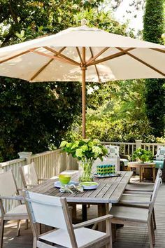 Vintage Cottage, Timeless Appeal This new deck, accessed from the dining room, was built with fir planks, keeping the footprint from a decrepit previous structure. Parasols, Patio Umbrellas, Deck Umbrella, Casa Patio, Backyard Patio, Porches, Outdoor Balcony, Outdoor Decor, Outdoor Rooms