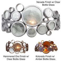 This stunning Fascination vanity light fixture features recycled bottle glass rounds framed with steel circles of varying sizes. This vanity fixture or wall sconce requires one 100-watt bulb.