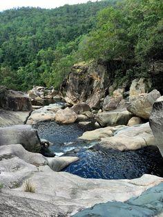 Natural rockslides, waterfalls, cliff jumping and crystal clear waterholes make up the beautiful Paluma Range National Park in Tropical North Queensland.