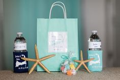 Nautical or beach wedding welcome bag idea - aqua gift bags with personalized koozies, water bottles, and colorful salt water taffy {shoreshotz photography}