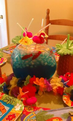 Blue punch with red gummy fish in a fish bowl fun party punch bowl for kids