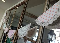 We mounted our DIY Bunting flags (free download on blog!) onto paper doilies and strung them across a vintage mirror.