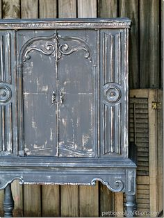 The Gray Cabinet - Loving this paint job on this beautiful cabinet.