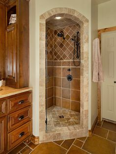 Outstanding Tiled Corner Showers With Glass Door Designs: Enchanting Tiled Corner Showers Combined With Wooden Vanity Unit And Brown Tile Floor ~ questushospitality.com Bathroom Designs Inspiration