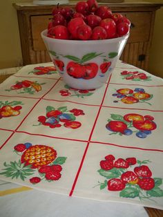 Vintage Kitchen Red Tea Towel Cherries Apple Fruit Roses  Tulip  Primary Fire King Apple. $9.99, via Etsy.
