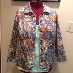 """CJ Banks Multicolor Floral Geometric Print Jacket Up for grabs is this jacket from CJ Banks. It is a CJ Banks size X, equivalent to a size 14W. This jacket measures 26.5"""" from shoulder to hem and 25"""" armpit to armpit laying flat. It has a multicolor floral and geometric print and buttons up the front. This coat is a lightweight cotton-spandex blend with front hip pockets. It has been gently worn and is in fantastic condition. CJ Banks Jackets & Coats"""