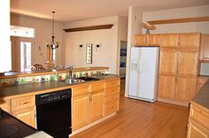 A spacious eat-in kitchen allows cooking and socializing to happen simultaneously