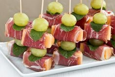 Prosciutto Wrapped Melon - an easy no-cook sweet salty appetizer perfect for the holidays. Using decorative food picks make a lovely presentation.