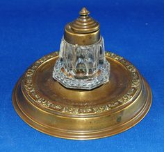 An attractive and unusual Victorian brass inkwell, with pepperpot style bottle
