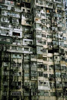 Battleship island in Japan. The entire island housed 3x what it should have, and managed it by putting them in obscenely crowded apartments like this. Now, the entire island is abandoned, and is restricted to the public. These derelict sky-scraping ghettos fall without an ear to hear them.: