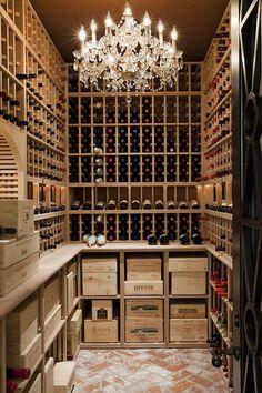 What an amazing wine cellar … from the sparkling chandelier to the raw wood shelving, rustic brick floor & heavy black door. #DuVino #wine www.vinoduvino.com