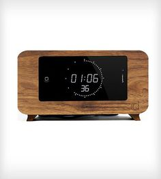 CDock iPhone Desk Clock If you love your iPhone this simple dock is a great addition to any Apple Mac lovers desk. With the ability to change your clock display you should never get bored looking at this sleek little iPhone holder. Iphone Clock, Iphone Charger, Iphone 4s, Iphone Docking Station, Objet Deco Design, Clock Display, Retro Clock, Gadget Gifts, Wooden Pallet Projects