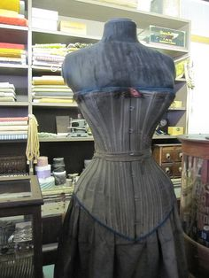 Lovely antique corset.  A very faded black, do you think?  I've never come across a grey before, but most fugitive blacks I've seen fade to brown or purple, not grey.
