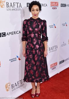 Flower power: Ruth Negga looked elegant in a pink and black dress...