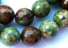"""Stone:African Green Opal Type:Natural Stone. Surface:Faceted. No of beads:28. Shape:Round. Length:Approx. 15.5"""" * Images are taken under bright white light."""