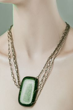 """Draped Chain - $73 by SHEILAFRANK.COM  Draped Chain Necklace  -Aventurine & transparent glass -Three Vintaj Natural Brass chains -Lobster claw closure -Dimensions: glass-2.5""""x1.5""""/ chain-19"""" with 3"""" extension -Colors: green (shown), black  • Handmade in America  PRE ORDER: PLEASE ALLOW UP TO 8 WEEKS. Deliveries for F..."""