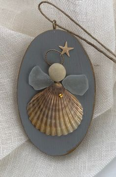 Excited to share this item from my #etsy shop: Coastal angel/shell angel /seaglass angel /shell ornament/beach ornament /beach wedding gift/Coastal Christmas/seaglass ornament/seaglassart