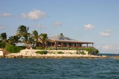 In the Florida Keys At MM 50 - East Sister Rock Island is a ¼ mile off the Atlantic shore of Marathon. On this private island sits a dream come true getaway home with 5000+ square feet of living area including a 2700 square foot veranda, boat dock (fisherman's dream), helicopter launch pad and many more surprises.
