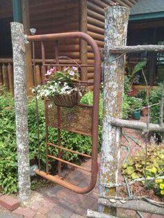Headboard repurposed into a garden gate. Love it!