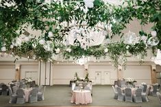 A gorgeous hanging chandelier of greenery at this fabulous wedding!