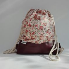 Handmade Backpack with flowerprint and red leather. For sale at DaWanda