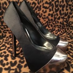 New Bebe Super Sexy Black Satin High Heels New, Never Worn. Sexy Black Satin High Heels by Bebe sister brand 2b. They have a shinny silver gray tip & heel. They silver gray areas are a soft material, there are a few small marks in the material. Not anything noticeable, please see pictures. They are a little too tight for me. bebe Shoes Heels