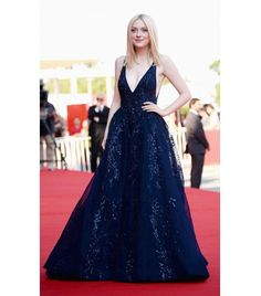 @Who What Wear - Dakota Fanning                 A plunging neckline takes some confidence to pull off, but the result is stunning, as proved by Fanning. Keep the rest of your look simple and modest, as not to distract from your décolletage.  On Fanning: Elie Saab Couture gown from the F/W 13 collection.
