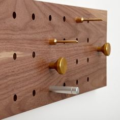 Rich Brilliant Willing coat rack with brass, aluminum, and steel pegs