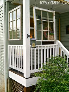 Windows hung on porch above railing. Makes it look like the porch is another room!