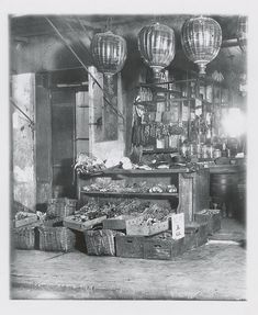 San Francisco Chinatown circa 1900    A study of a neighborhood grocery whose offerings include sausages, fresh vegetables and greens, as well as pickled and canned goods. Photograph by Arnold Genthe.
