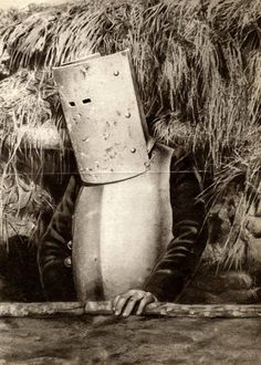 First World War. A French soldier wearing a kind of armor as protection against flying bullets above the trench. France 1915.
