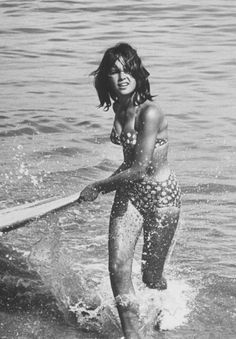 Allan Grant, A surf rider returning after surfing, California, 1961