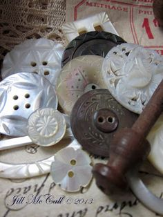Delicately carved MOP buttons ~ so lovely.