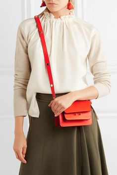 Tomato-red leather (Calf) Push clasp-fastening front flap Designer color: Poppy Red Comes with dust bag Weighs approximately 1.1lbs/ 0.5kg  Made in Italy