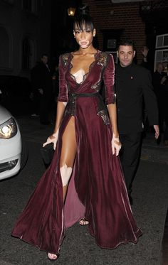 f031e7e024ade Winnie Harlow flaunts her perky assets in a plunging velvet gown in London
