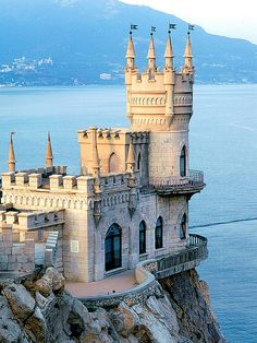 Ukraine - Swallows Nest Castle.  Facts of Ukraine: Area: 603,700 sq km. A flat, fertile, forested plain with few natural boundaries. Population: 45,433,415. Capital: Kyiv (Kiev). Official language: Ukrainian, but Russian widely spoken. Languages: 42