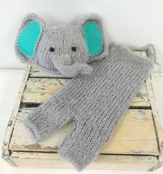 The cutest little elephant set ever! Adorable beanie with inner ears in blue or pink The trunk is stitched up so that it does not hang in babys eyes.  Soft and stretchy dungarees with neck ties so that they fit baby easily.  Made from soft, brushed South African Mohair. Made in sizes Newborn through to 9 months (Sitter size)  Handwash and dry flat   ******************************** Made with loving care, by me (Tania) in Port Elizabeth, South Africa.  I make custom orders with pleasure…