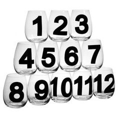 Set of twelve stemless goblets with black numbering.   Product: 12 GobletsConstruction Material: GlassColor: Clear and blackFeatures: 18 Ounce capacity eachNumber detail on each
