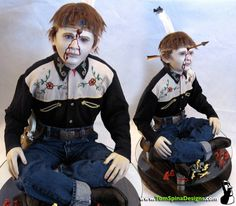 """Amazingly realistic head and unique posing and custom base make this """"First Born Son"""" display an incredible addition to our lineup from 13 Ghosts.  Once again, the costume is all screen used.  Our display breathes eerie life into this creepy child-ghost!"""